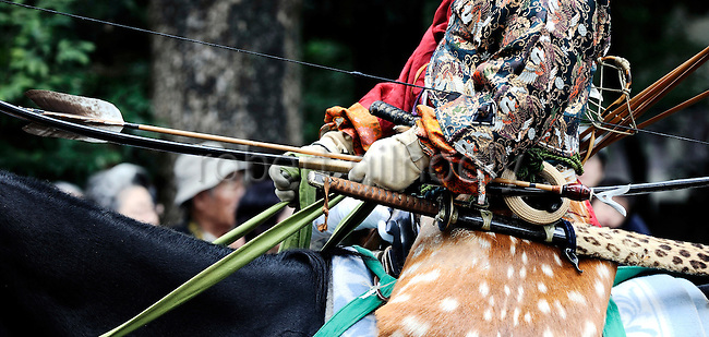 A horseback archer dressed in a traditional hunting garb is escorted along a 255-meter course during the Yabusame Shinji, a Japanese ritual, at Tsurugaoka Hachimangu shrine in Kamakura, near Tokyo. The ritual, which involves several riders on horseback firing arrows at targets while galloping at speed, dates back to the 12th century and is aimed at appeasing the numerous gods that guard Japan. It was initiated by Kamakura shogun Minamoto no Yoritomo  in an attempt to improve his samurai warrior's appalling archery skills.