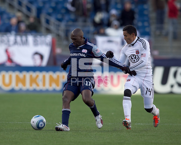 New England Revolution forward Kheli Dube (11) fends off DC United midfielder Andy Najar (14). In a Major League Soccer (MLS) match, the New England Revolution defeated DC United, 2-1, at Gillette Stadium on March 26, 2011.