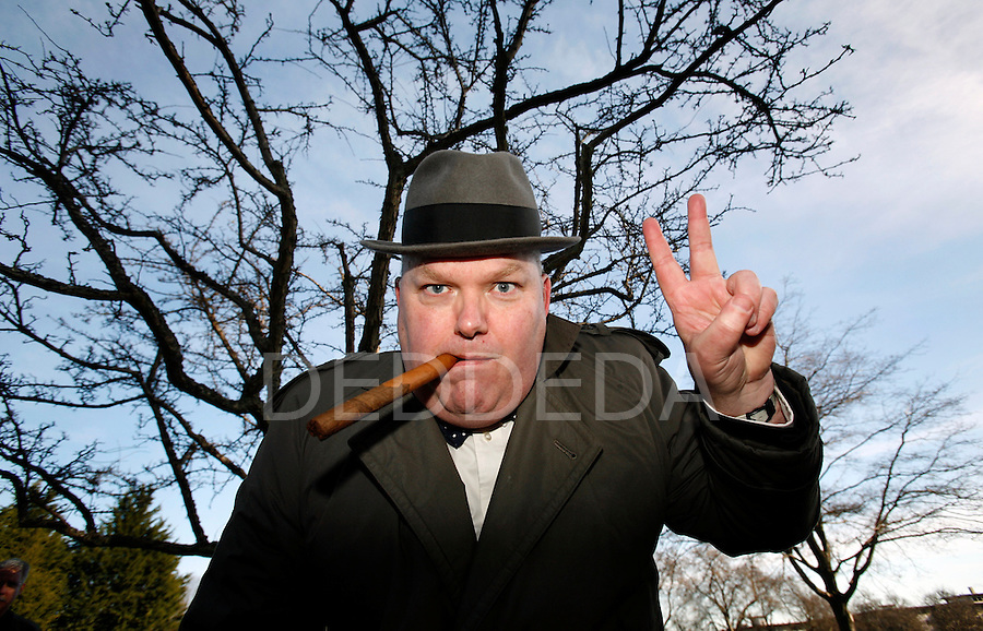 Sir Winston Churchill, played by Chris Gainor, the temporary communications director of the NDP caucus, gives the Victory sign to a small crowd at Mayors Grove in Beacon Hill Park in Victoria, British Columbia. The gathering in the park, around the Hawthorn tree shown behind Gainor, was planted by Churchill himself on September 6, 1929. The group commemorated Churchill's death at age 90 on January 24, 1965. Photo assignment for the Globe and Mail national newspaper in Canada.