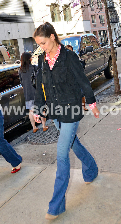 **ALL ROUND PICTURES FROM SOLARPIX.COM**                                 **WORLDWIDE SYNDICATION RIGHTS**                   Caption:  American actress Katie Holmes-Cruise enjoying a sunny day out with her mother & daughter Suri in New York USA.                                                                         .This pic: Katie Holmes                                                                                     JOB REF: 14589       NYK       DATE:20.03.2012                                                             **MUST CREDIT SOLARPIX.COM OR DOUBLE FEE WILL BE CHARGED**                                                                        **MUST NOTIFY SOLARPIX OF ONLINE USAGE**                 **CALL US ON: +34 952 811 768 or LOW RATE FROM UK 0844 617 7637**