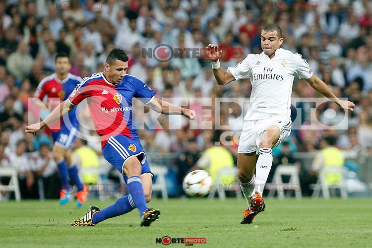 Pepe of Real Madrid and Derlis Gonzalez of FC Basel 1893 during the Champions League group B soccer match between Real Madrid and FC Basel 1893 at Santiago Bernabeu Stadium in Madrid, Spain. September 16, 2014. (ALTERPHOTOS/Caro Marin) /NortePhoto.com