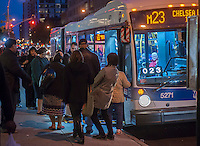 Commuters board an M23 bus in in Gramercy Park in New York on Tuesday, October 29, 2013. (© Richard B. Levine)