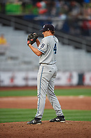 West Michigan Whitecaps relief pitcher Will Vest (4) looks in for the sign during a game against the Quad Cities River Bandits on July 22, 2018 at Modern Woodmen Park in Davenport, Iowa.  West Michigan defeated Quad Cities 6-4.  (Mike Janes/Four Seam Images)