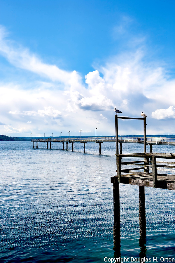 The long fishing pier at Des Moines marina extends far over Puget Sound.  It's popular with walkers, fishermen, and tourists alike.