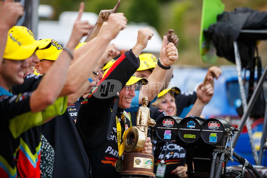 Jun 18, 2017; Bristol, TN, USA; NHRA top fuel driver Clay Millican (center) celebrates with his crew after winning the Thunder Valley Nationals at Bristol Dragway. Mandatory Credit: Mark J. Rebilas-USA TODAY Sports