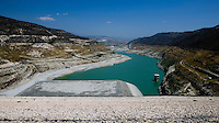 The water level in Kourris dam, when full, is marked by the dark vegetation high on the hills. Now it's nearly empty like the other 55 damns in Cyprus. Agriculture doesn't get any water from the reservoirs, boreholes are used to water the plants and livestock..