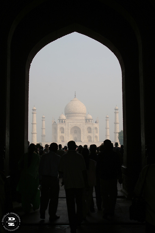Every day thousands of tourist visit the Taj Mahal in Agra, India. The Taj Mahal is regarded by many as one of the eight modern wonders of the world. The mausoleum was built by Mughal Emperor Shah Jahan to immortalize his love for his wife Mumtaz Mahal.  Construction for the Taj Mahal began in 1631 and completed in 1653.  Photograph by Douglas ZImmerman