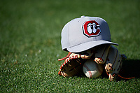 A Chattanooga Lookouts hat rests on a glove before a game against the Jackson Generals on April 27, 2017 at The Ballpark at Jackson in Jackson, Tennessee.  Chattanooga defeated Jackson 5-4.  (Mike Janes/Four Seam Images)