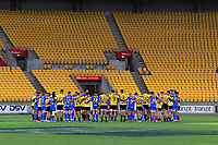 The teams observe a minute's silence in memory of victims of the Christchurch terror attack before the Super Rugby match between the Hurricanes and Stormers at Westpac Stadium in Wellington, New Zealand on Saturday, 23 March 2019. Photo: Dave Lintott / lintottphoto.co.nz