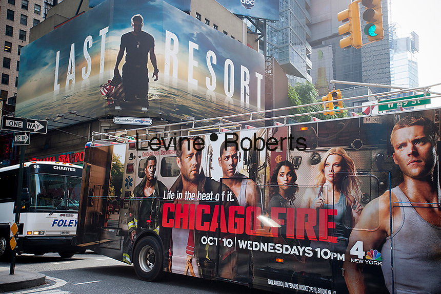 Advertising on billboards for the ABC television program Last Resort in Times Square competes with NBC's advertising for Chicago Fire on the side of a tour bus on Wednesday, October 17, 2012. (© Richard B. Levine)