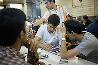 June 07, 2014 - Tabriz, Iran. Iranian youths play backgammon on a tablet in a traditional cafe. Despite slow mobile internet connections, Iran has seen a considerable increase of consumers purchasing smartphones. © Thomas Cristofoletti / Ruom