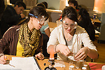 Education High School Grade 10 chemistry class lab, students wearing protective goggles as they use bunsen burner