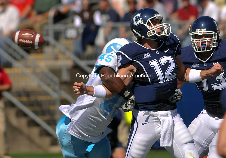 EAST HARTFORD, CT- SEPTEMBER 26, 2009-092609JS01--UConn's quarterback Cody Enders (12) fumbles the ball after getting hit by Rhode Island's Steve Weedon (45) during their game Saturday at Rentschler Field in East Hartford. <br /> Jim Shannon Republican-American