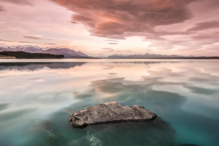 Lenticular clouds at sunset over Lake Puakaki, Mackenzie Country, New Zealand