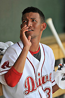 Starting pitcher Roniel Raudes (34) of the Greenville Drive cools off in the dugout between innings of a game against the Lakewood BlueClaws on Sunday, June 26, 2016, at Fluor Field at the West End in Greenville, South Carolina. Greenville won, 2-1. (Tom Priddy/Four Seam Images)