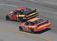 May 6, 2007; Richmond, VA, USA; Nascar Nextel Cup Series driver Juan Pablo Montoya (42) leads Tony Stewart (20) during the Jim Stewart 400 at Richmond International Raceway. Mandatory Credit: Mark J. Rebilas