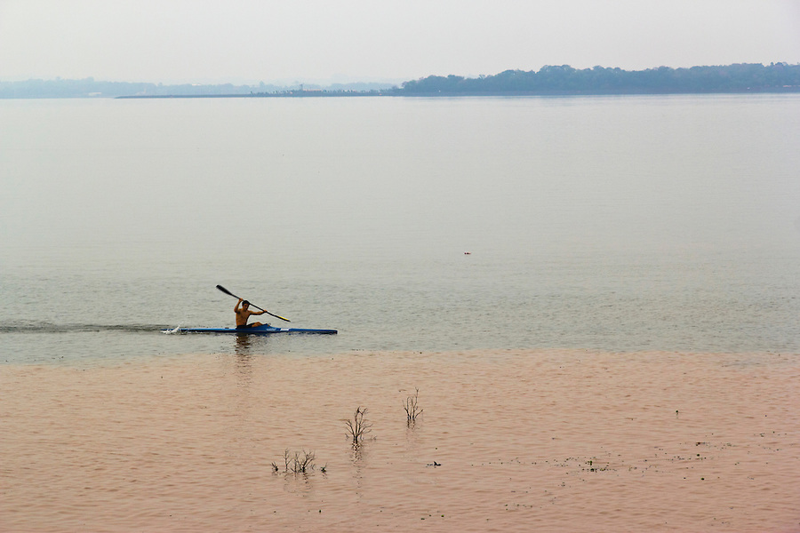Kayaker on the Parana River at Posadas, Misiones, Argentina.