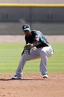 Carlos Triunfel #50 of the Seattle Mariners participates in spring training workouts the Mariners minor league complex on March 12, 2011  in Peoria, Arizona. .Photo by:  Bill Mitchell/Four Seam Images.