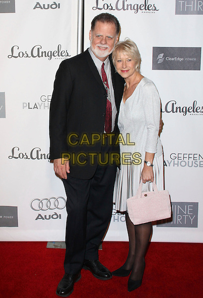 TAYLOR HACKFORD & DAME HELEN MIRREN.Annual Backstage At The Geffen Gala held at the Geffen Playhouse, Los Angeles, California, USA..March 9th, 2009.full length black shoes silver grey gray skirt top pale pink bag purse suit married husband wife .CAP/ADM/KB.©Kevan Brooks/AdMedia/Capital Pictures.