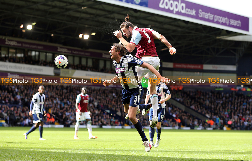 Andy Carroll of West Ham beats Jonas Olsson of West Brom to the ball and gets a header on goal - West Bromwich Albion vs West Ham United, Barclays Premier League at The Hawthorns, West Bromwich - 26/04/14 - MANDATORY CREDIT: Rob Newell/TGSPHOTO - Self billing applies where appropriate - 0845 094 6026 - contact@tgsphoto.co.uk - NO UNPAID USE