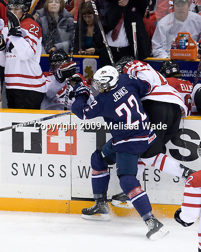 AJ Jenks (USA - 22), Greg Nemisz (Canada - 16) - Team Canada defeated Team USA 5-4 (SO) on Thursday, December 31, 2009, at the Credit Union Centre in Saskatoon, Saskatchewan, during the 2010 World Juniors tournament.