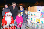 Donal Brennan Killorglin and Kelly Carr who won an art competition to switch on the Christmas lights on the Memory Tree in Killorglin on Saturday night in aid of the Irish Pilgrimage Trust front row l-r: Santa Claus, Kelly Carr, Donal Brennan. Back row: Anthony O'Connor, Denis McCarthy, Tom Crowley