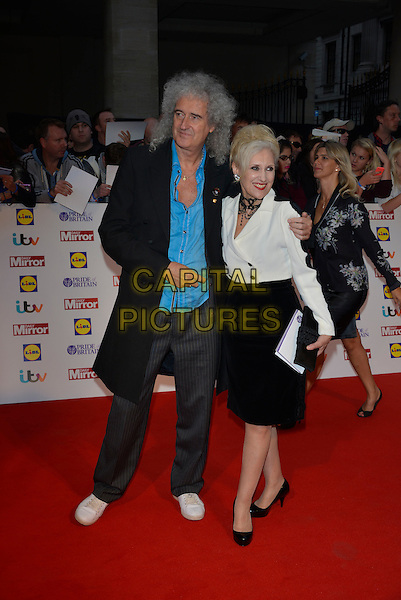 Brian May, Anita Dobson<br /> The Daily Mirror's Pride of Britain Awards arrivals at the Grosvenor House Hotel, London, England.<br /> 7th October 2013<br /> full length black coat blue turquoise shirt jeans denim white top skirt married husband wife<br /> CAP/PL<br /> &copy;Phil Loftus/Capital Pictures