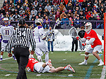 University at Albany Men's Lacrosse defeats Cornell 11-9 on Mar 4 at Casey Stadium.  Connor Fields (#5) shoots after freeing himself from Jake Pulver (#34).