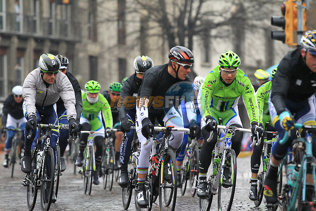 The well wrapped pelethon including World Champion Philippe Gilbert (BEL) BMC Racing Team chatting to Peter Sagan (SVK) Cannondale Pro Cycling pass through Pavia during the 104th edition of the Milan-San Remo cycle race, 17th March 2013 (Photo by Eoin Clarke 2013)
