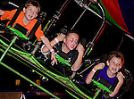 "Photo by Phil Grout..Ryan Davis (left), Dakota Flanary and Jake Bower get their toughness tested as they hang for dear life to their ""Cliff Hanger"" vehicle while sailing through Westminster's Fall Fest at break-neck speeds."