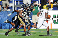 20 September 2008:  FIU defensive back Marshall McDuffie (22) pursues South Florida running back Moise Plancher (3) on the way to a USF touchdown in the first quarter at FIU Stadium in Miami, Florida.