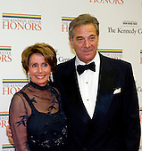 United States House Democratic Leader Nancy Pelosi (Democrat of California) and her husband, Paul, arrive for the formal Artist's Dinner honoring the recipients of the 2012 Kennedy Center Honors hosted by United States Secretary of State Hillary Rodham Clinton at the U.S. Department of State in Washington, D.C. on Saturday, December 1, 2012. The 2012 honorees are Buddy Guy, actor Dustin Hoffman, late-night host David Letterman, dancer Natalia Makarova, and the British rock band Led Zeppelin (Robert Plant, Jimmy Page, and John Paul Jones)..Credit: Ron Sachs / CNP