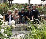 5-30-09 .Exclusive.Tommy Lee picking up a turtle in the Pond at the Calabasas Commons shopping center just outside of Los Angeles California. The girl with him looks like Vivid porn star Stefani Morgan. They are rumored to be dating...AbilityFilms@yahoo.com.805-427-3519.www.AbilityFilms.com.
