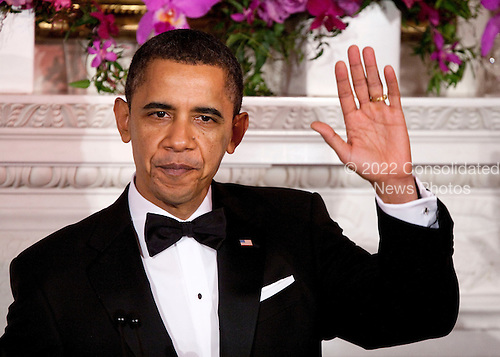 United States President Barack Obama waves at the start 2011 Governors Dinner at the White House in Washington, D.C., U.S., on Sunday, February 27, 2011. .Credit: Joshua Roberts / Pool via CNP