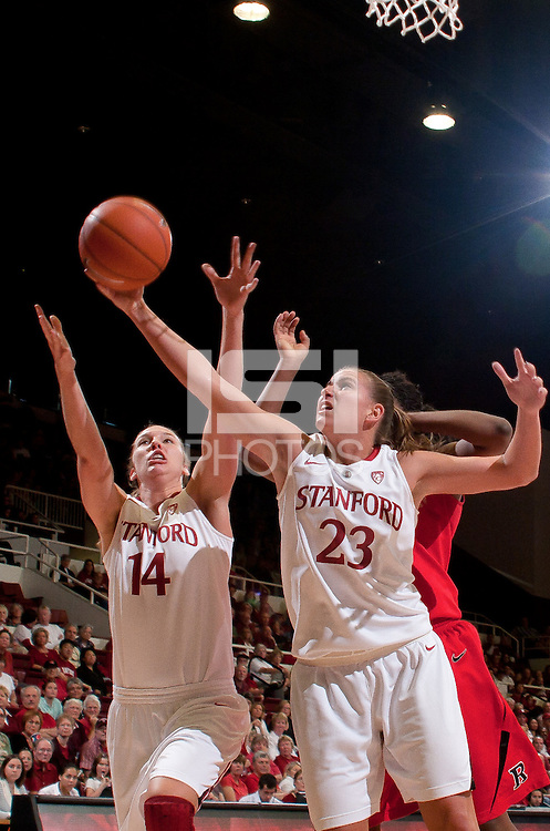STANFORD, CA - November 14, 2010: Jeanette Pohlen (23) and Kayla Pedersen (14) during a basketball game against Rutgers at Stanford University in Stanford, California. Stanford won 63-50.