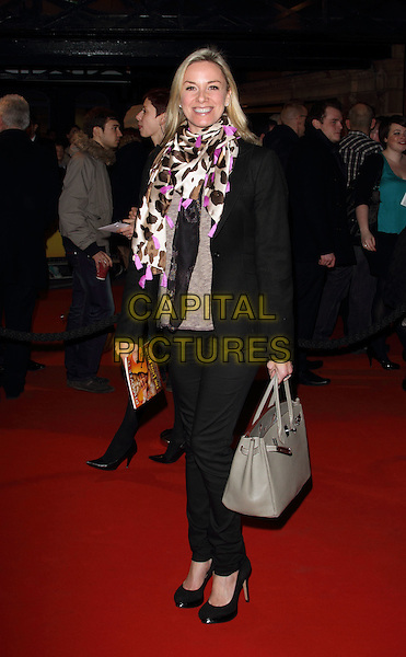 Tamzin Outhwaite.Opening Night of 'Singin' in the Rain' at the Palace Theatre, Shaftesbury Avenue, London, England..February 15th 2012.full length suit black trousers jacket white pink purple print scarf grey gray bag purse.CAP/ROS.©Steve Ross/Capital Pictures