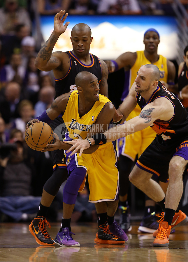 Jan. 30, 2013; Phoenix, AZ, USA: Los Angeles Lakers guard Kobe Bryant (24) drives to the basket against Phoenix Suns center Marcin Gortat (4) at the US Airways Center. Mandatory Credit: Mark J. Rebilas-