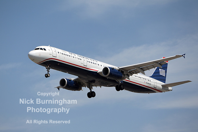 LOS ANGELES, CALIFORNIA, USA - MARCH 21, 2013 - US Airways Airbus A321-231 lands at Los Angeles Airport on March 21, 2013. It has a range of 5,600 km and seats 185 people.