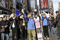 "NEW YORK - OCT 29: Snowboarder Kelly Clark takes a ""selfie"" amidst tourists. Olympic athletes participate in 100 Days to Sochi, a promotional event for the US Olympic Team, on Tuesday, October 29, 2013 in New York City. (Photo by Landon Nordeman)"
