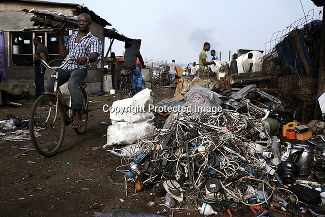 ACCRA, GHANA APRIL 19: People at work at Agbogbloshie, a huge recycling area on April 19, 2015 in central Accra, Ghana. Everything is recycled and bartered here. Most popular are recycled e-waste and car parts.  It has been called an e-waste dumping ground. (Photo by: Per-Anders Pettersson)