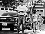 Republican U.S. Senate candidate Danny Tarkanian, along with his daughters Ava and Lois, walk door to door campaigning in the Summerlin neighborhood of Las Vegas, Nevada, on May 30, 2010, during the Republican primary race.