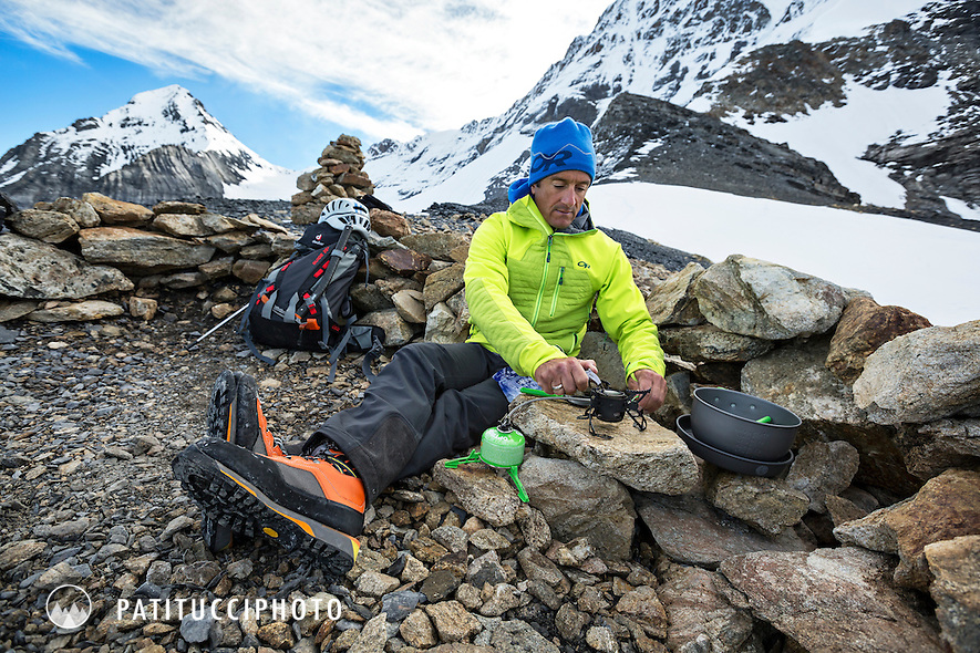Using a camp stove at a high alpine bivouac camp on the Mönch, in the Berner Oberland, above Grindelwald, Switzerland.