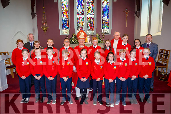 Pupils of Bouleenshere NS Ballyheiguie who made their confirmation on Wednesday in St Mary's Church,Ballyheigue with the pupils were, Terence Dineen (principal) Pat Carmody (teacher) and Frb O'Mahony.