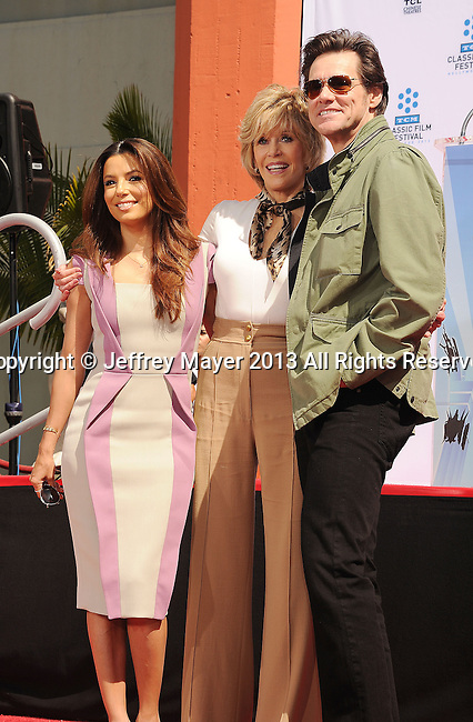HOLLYWOOD, CA- APRIL 27: Actors Eva Longoria, Jane Fonda and Jim Carrey attend actress Jane Fonda's Handprint/Footprint Ceremony during the 2013 TCM Classic Film Festival at TCL Chinese Theatre on April 27, 2013 in Los Angeles, California.