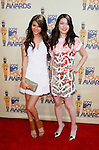 UNIVERSAL CITY, CA. - May 31: Actors Victoria Justice and Miranda Cosgrove . arrive at the 2009 MTV Movie Awards held at the Gibson Amphitheatre on May 31, 2009 in Universal City, California.