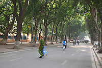 Trees align the roads in the middle of Hanoi.<br />