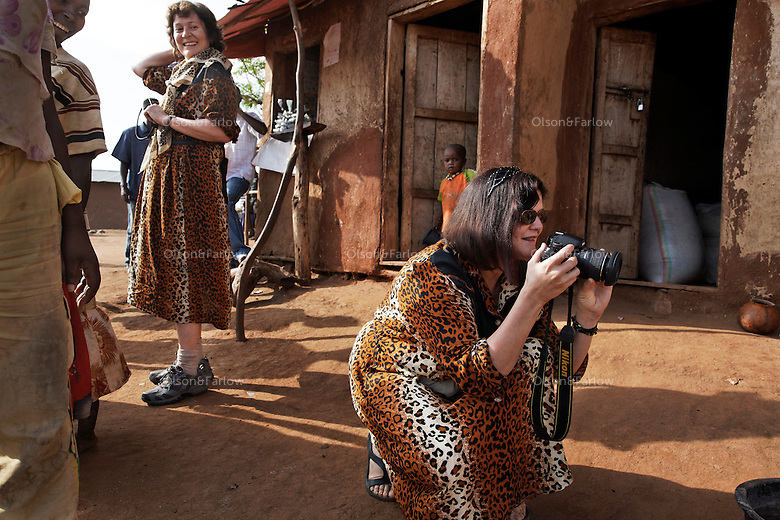 Austrian tourists in matching fake cheetah outfits shoot snapshots of locals.  Tourists in this valley have trained the locals to beg for money in return for being photographed.  This burns the idea into young African minds that for them to GET anything they have to beg for it from people that live in richer countries.