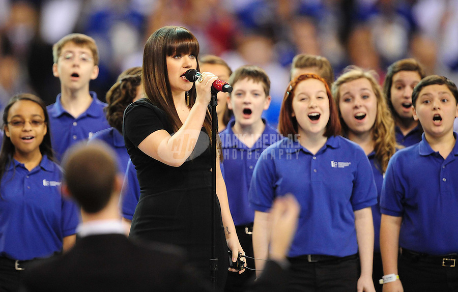 Feb 5, 2012; Indianapolis, IN, USA; Recording artist Kelly Clarkson performs the national anthem before Super Bowl XLVI between the New England Patriots and the New York Giants at Lucas Oil Stadium.  Mandatory Credit: Mark J. Rebilas-