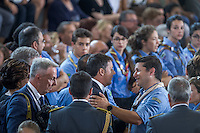 Matteo Renzi and a scout during the Funeral earthquake on PalaSport Monticelli in Ascoli Piceno  August 27, 2016, in Marche, Italy. Photo by Adamo Di Loreto