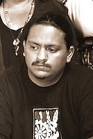 AJ Alexander -  Black Brown Coalition Meeting with Carlos Garcia at El Portada 117 W. Grant Phoenix, Arizona on Thursday May 17, 2012..Photo by AJ Alexander